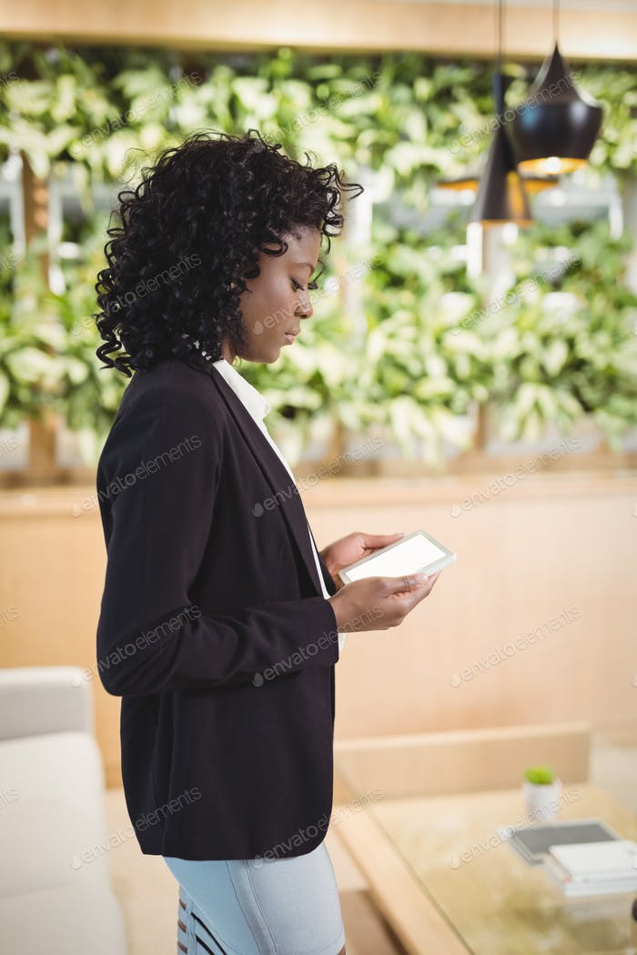 Attentive businesswoman using digital tablet