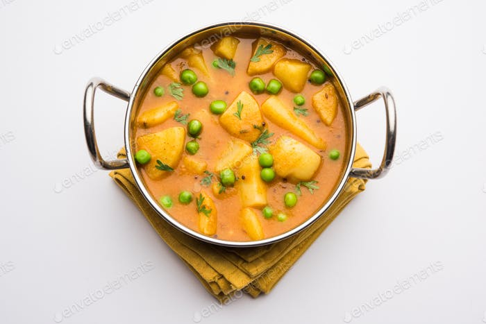 Indian style potatoes spicy curry made using boiled potato with green peas