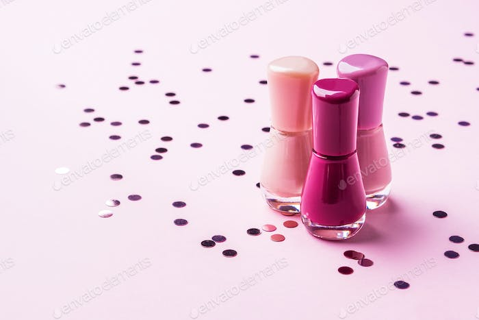 Pink nail polish bottles with sparkling confetti
