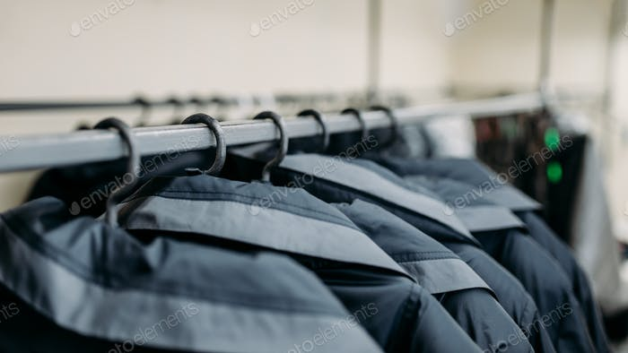 Clothes on hangers, sewing factory or dress fabric