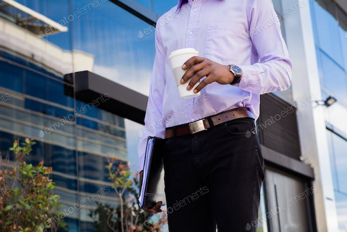 Businessman taking a break from work and drink coffee.