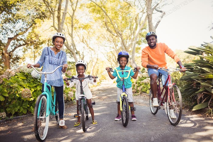 Happy family doing bicycle
