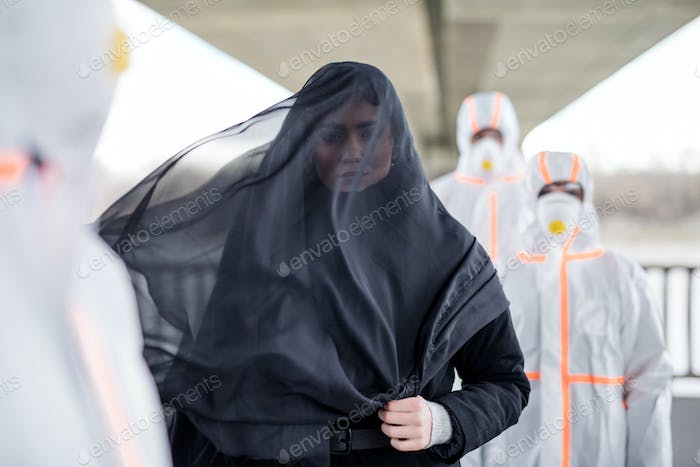 People with protective suits outdoors, coronavirus and death concept