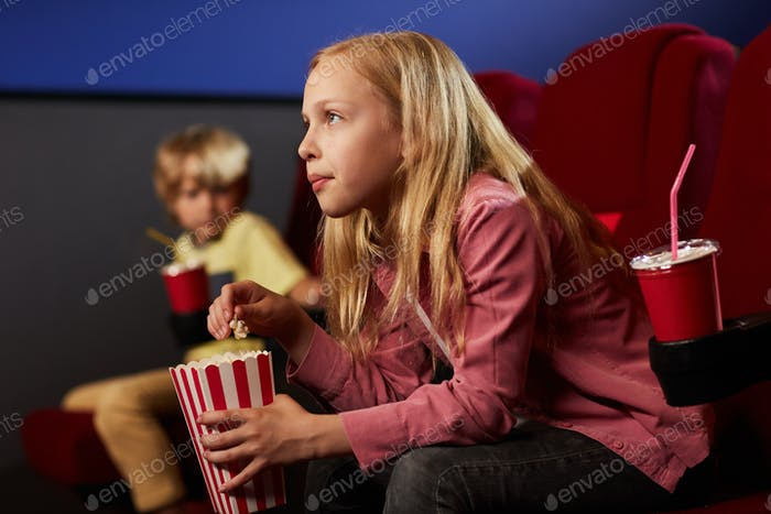 Blonde Teenage Girl in Cinema