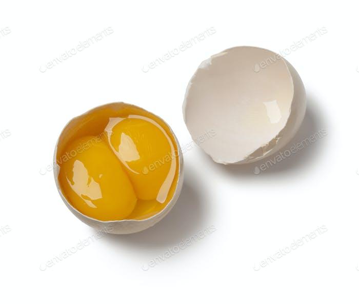 Broken double yolk egg in the shell