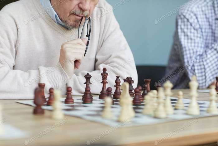Focused experienced chess player