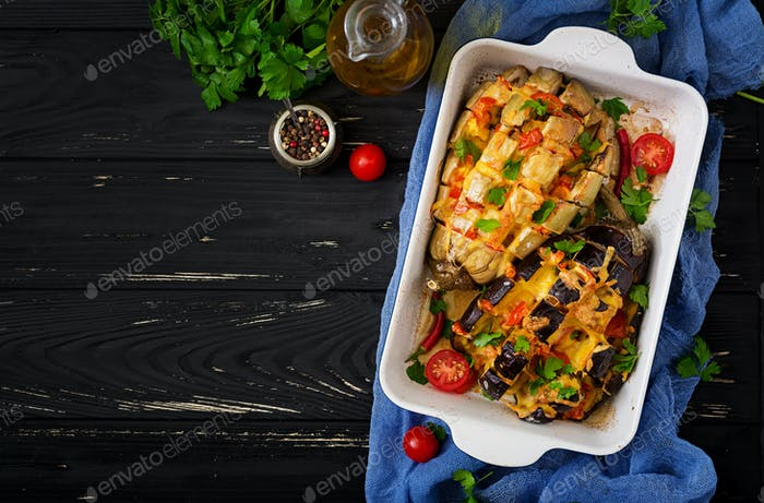 Eggplant baked with cheese and tomatoes. Flat lay. Top view
