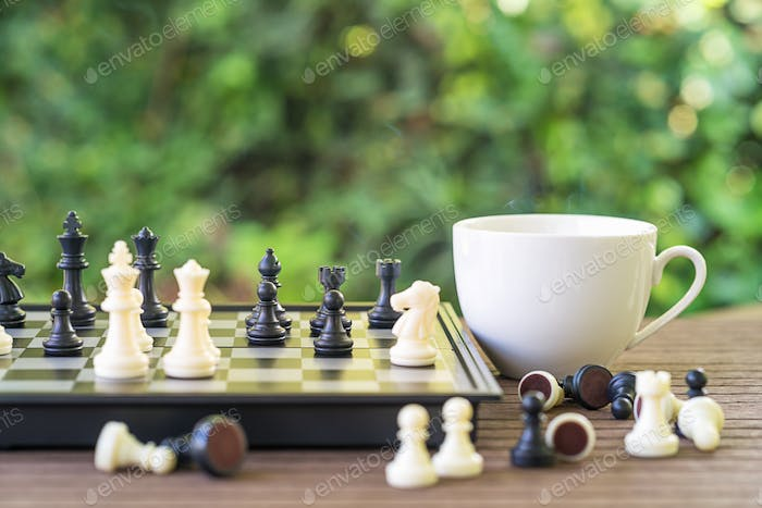 Coffee cup on wood table with Chess board-3