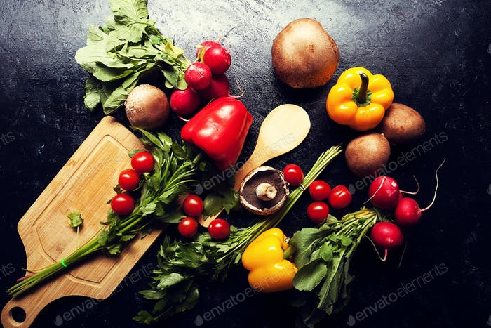 Over top view of different type of vegetables on dark board