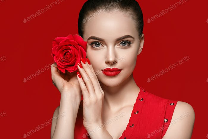 Woman with rose flower. Beauty female portrait with beautiful rose flower and salon.