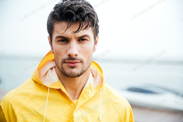 Close up portrait of a sailor man in yellow cloak