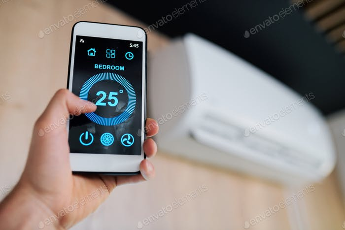 Optimal temperature of air in the room shown on display of smartphone