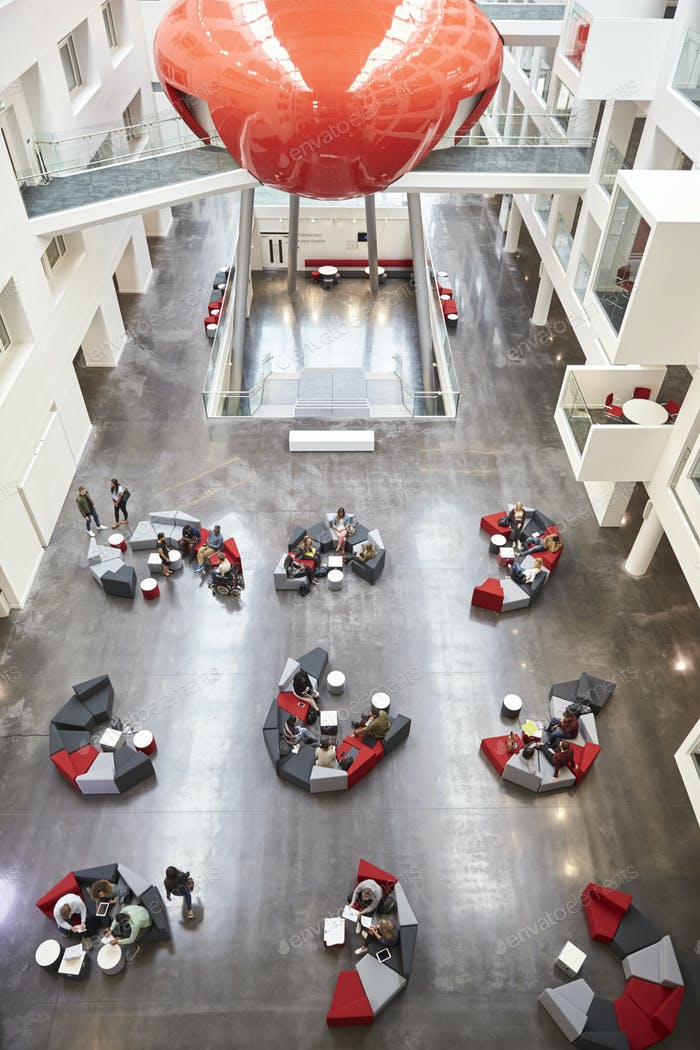 Seating in the atrium of modern university building, vertical