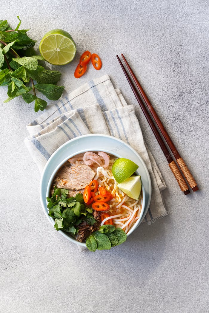 Bun Bo Hue, Bun Bo, Vietnamese beef noodle soup spicy. bowl of beef and rice vermicelli soup