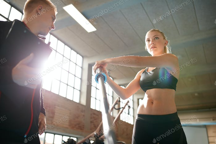 Woman exercising with the supervision of a personal trainer