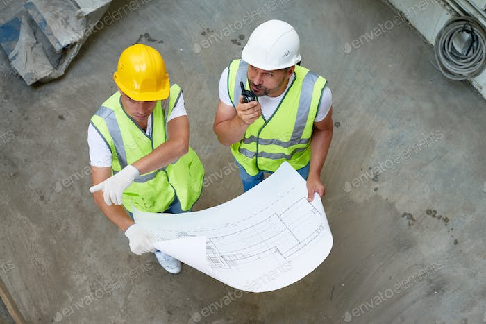 Construction Workers Wrapped up in Discussion
