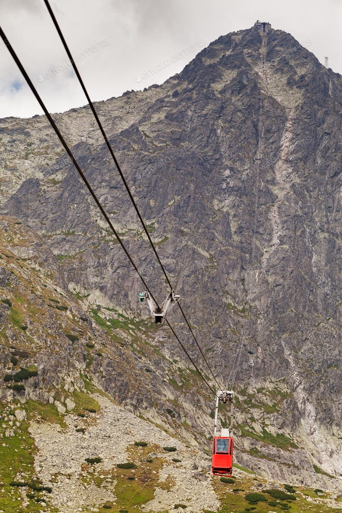 Wagon cable car against the background of beautiful rocky mountains