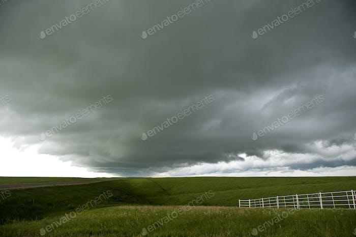 55205,Storm clouds over rural landscape
