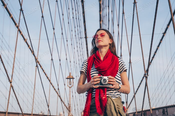 Young photographer on the Brooklyn Bridge