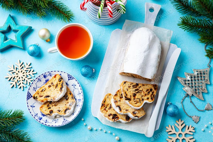 Christmas Stollen cake with Icing Sugar, Marzipan and Raisins. Top View.