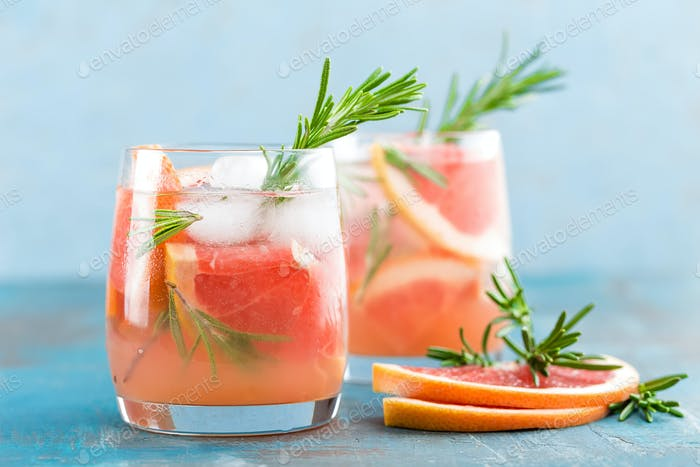 Grapefruit and rosemary gin cocktail, refreshing drink with ice