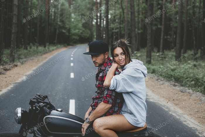 Caucasian couple on motorcycle