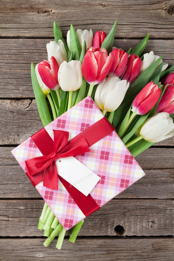 Colorful tulips bouquet and gift box