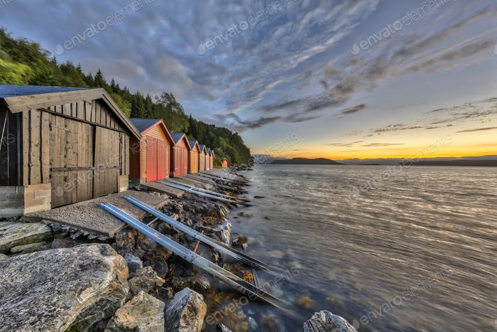 Sunset with Colorful Boathouse in Norwegian fjord