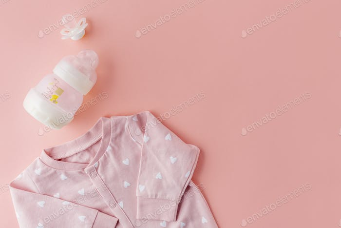 Baby goods on pastel pink background