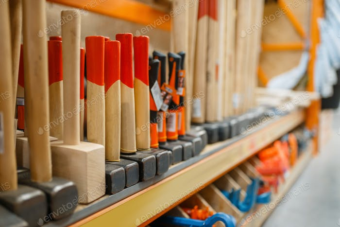 Hardware store assortment, shelf with hammers