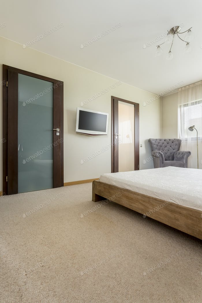 Bright bedroom with wooden bed