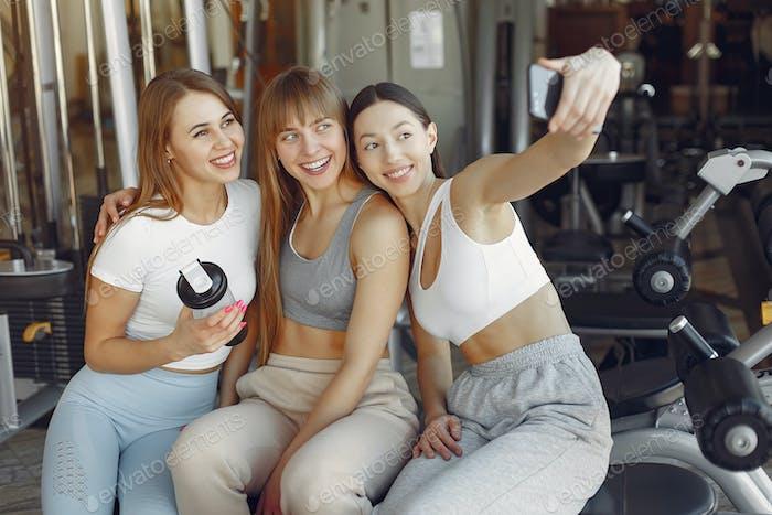 A beautiful girls sitting in a gym