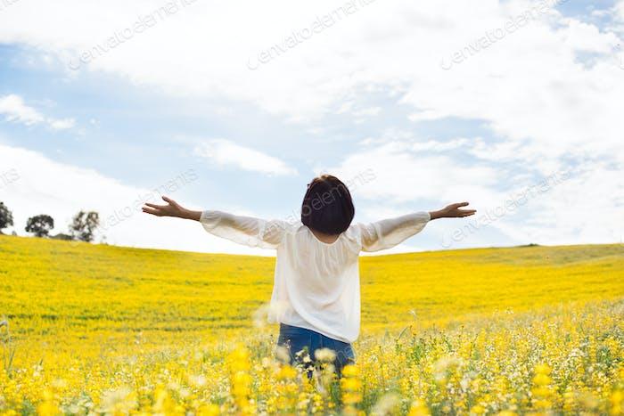 Woman in yellow field