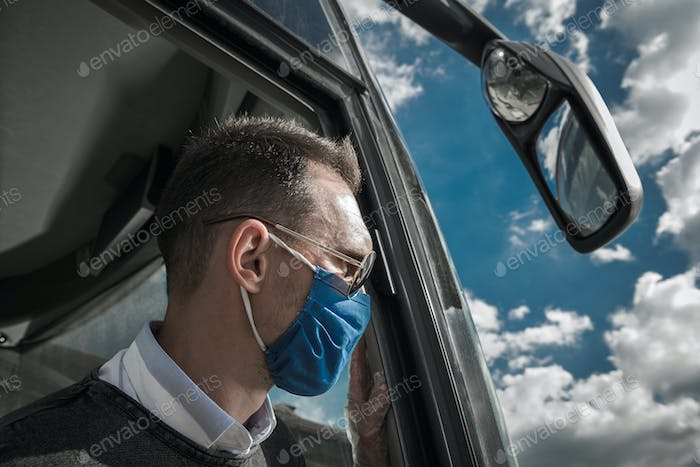 Caucasian Shuttle Bus Driver in Face Mask During Pandemic