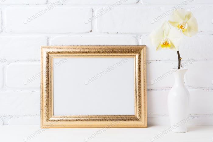 Golden  landscape frame mockup with soft yellow orchid in vase