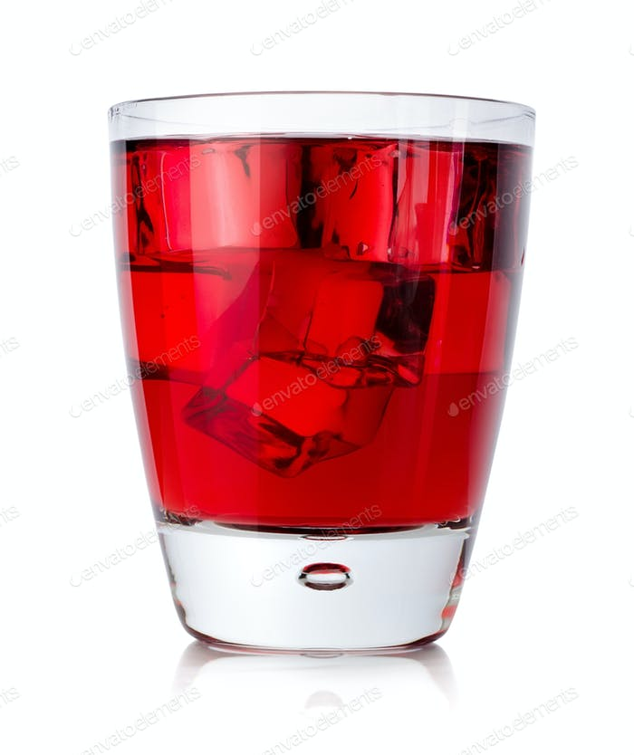 Red drink with ice cubes in a glass