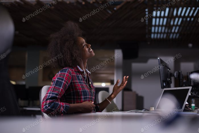 woman at her workplace in startup business office listening musi