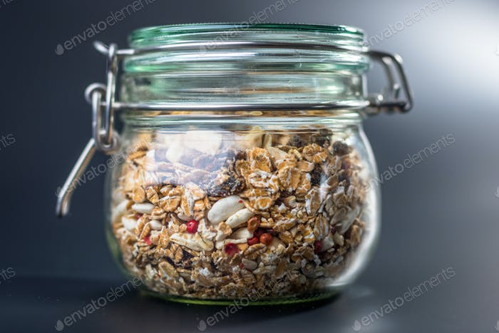 Granola with nuts and seeds in glass jar