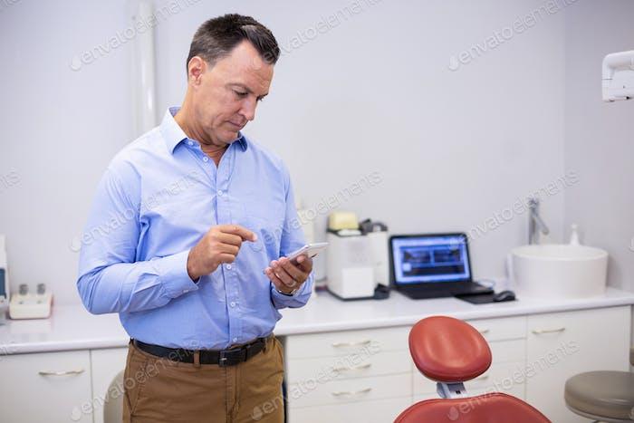 Dentist using mobile phone