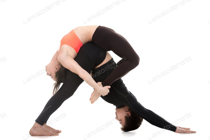 Acroyoga, downward-facing dog and bow pose