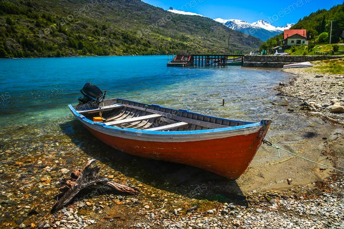 Small boat on Patagonian lakeshore