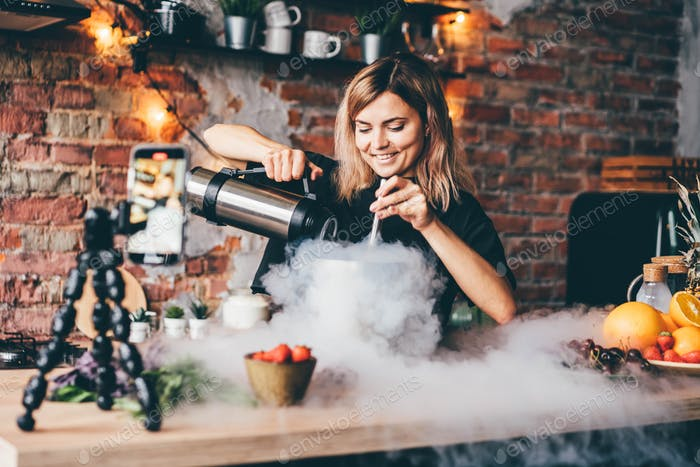 Culinary blogger pours liquid nitrogen into silver container