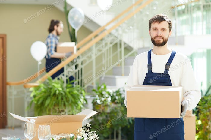 Content bearded mover delivering boxes