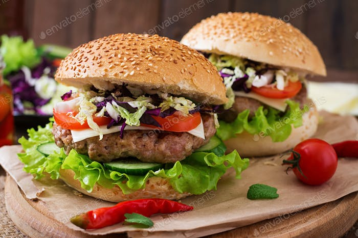 Sandwich hamburger with juicy burgers, cheese and mix of cabbage
