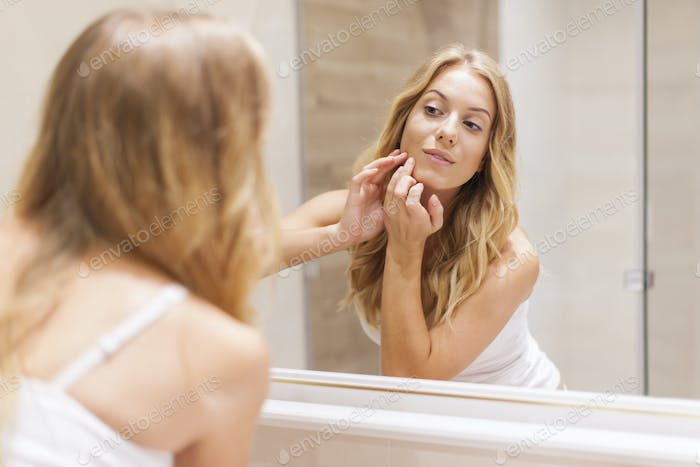 Blonde woman has problems with skin on the face