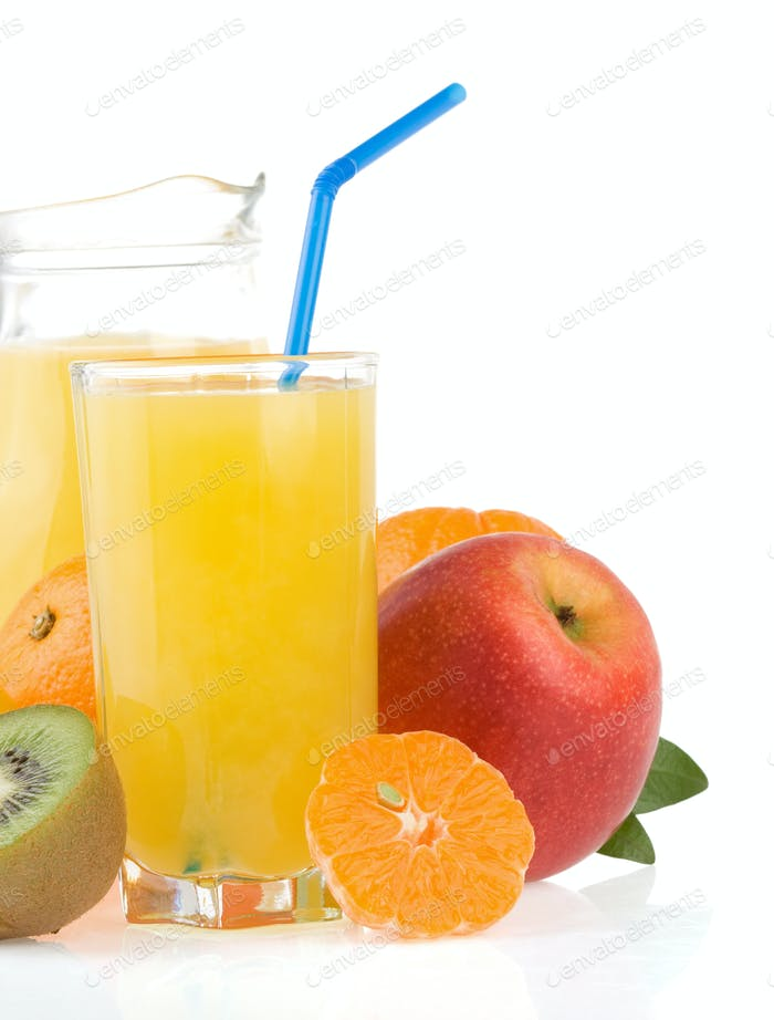 fresh tropical fruits and juice in glass