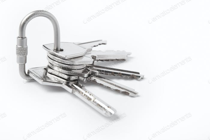 Key ring with keys over white background. Rent, buy home