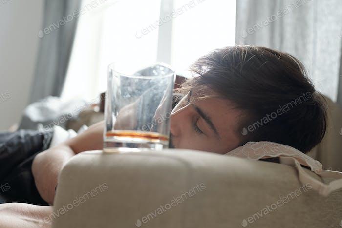 Party boy sleeping on brassiere