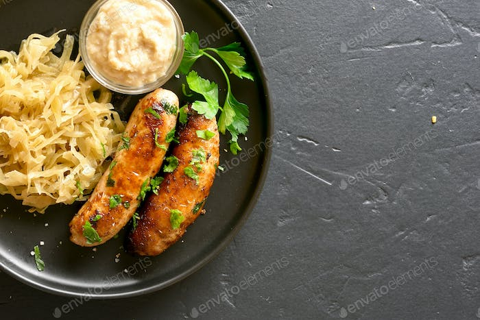 Grilled sausages with sauerkraut and horseradish