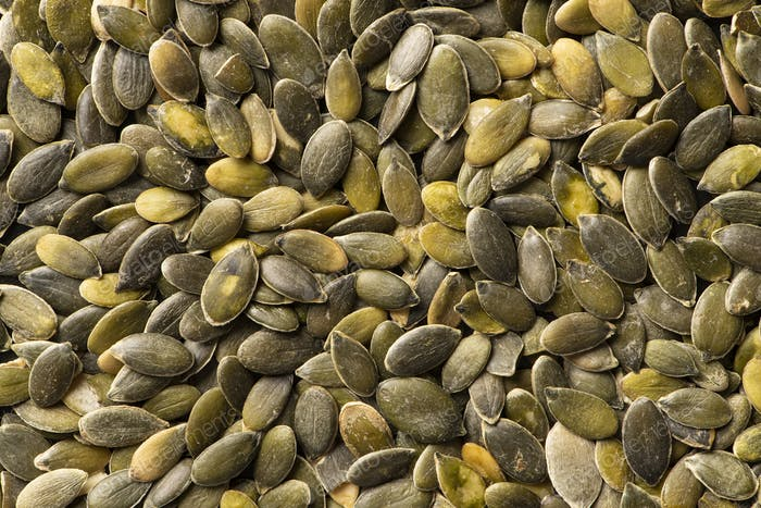 Background texture of green pumpkin seeds